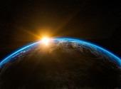 Lever de soleil derrière la terre Photos