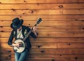 Homme jouant du banjo Photos