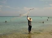 Pêcheur sur la plage